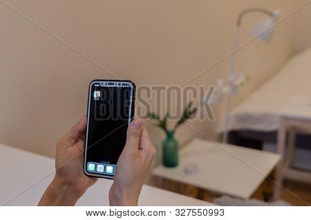 Elva, Estonia November 15, 2018 Girl Holding Iphone With Online Fortnite Game Epic Games Logo On Dis