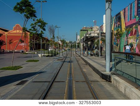 Rio De Janeiro, Rj , Brazil - May 22, 2018:  People Wait For The Approaching Vlt Carioca Line 1 At S