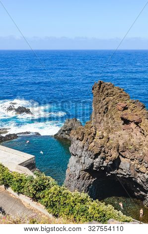 Tourists Swimming In Natural Pools In The Atlantic Ocean In Seixal, Madeira Island, Portugal. Pool S