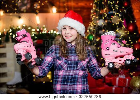 Got Gift Exactly She Wanted. Kid Near Christmas Tree Hold Roller Skates. Girl Satisfied Christmas Gi