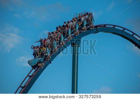 Orlando, Florida. October 5, 2019. People Having Fun Amazing Mako Roller Coaster At Seaworld 209