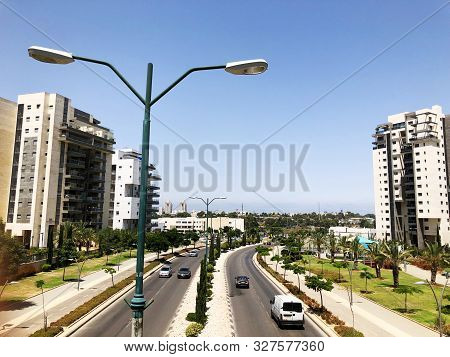 Rishon Le Zion, Israel  October 07, 2019: Residential Buildings, Plants And Highway In Rishon Le Zio