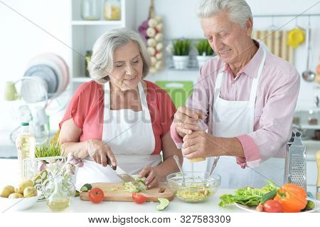 Close Up Portrait Of Senior Couple Cooking
