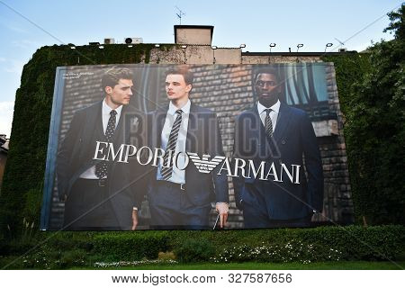 Milan, Italy, 08.04.2019: A Giant, Enormous Emporio Armani Poster With Three Young Men In Suits On A