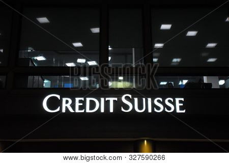 Milan, Italy, 08.04.2019: Logo Of The Swiss Credit Suisse Banking Group, During The Night In The Hea