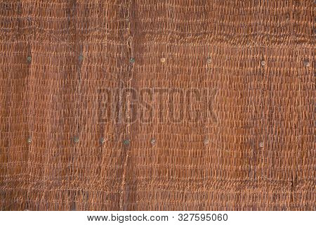 Straw Woven Fabric With Uneven Dusty Structure, Textured Background.