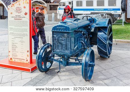 Moscow, Russia - October 08, 2019: Men Near Restored American Wheel Tractor Fordson F On The Exhibit