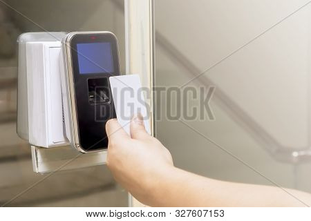 Close Up Of The Hand With Key Card Are Scanning For Enter Digital Security Door System In The Office
