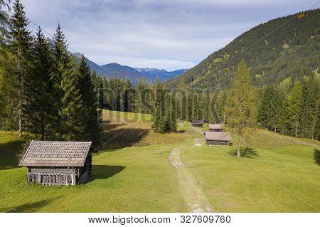 Wooden Farm Huts On Mountain Meadow At Fall Autumn In Tirol Austria