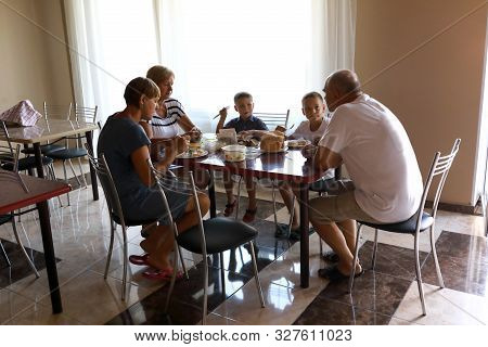 Family Has Breakfast In The Dining Room
