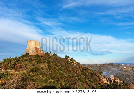 Amazing landscape of the Tuscan countryside with the medieval fortress Rocca of Tentennano on the hill in winter. Tuscany, Italy. poster