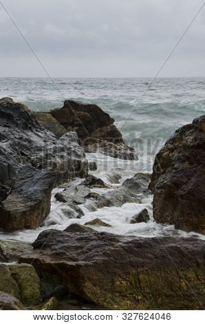 Sea water flows between the rocks of the coast in the Tayrona National Park, Colombia