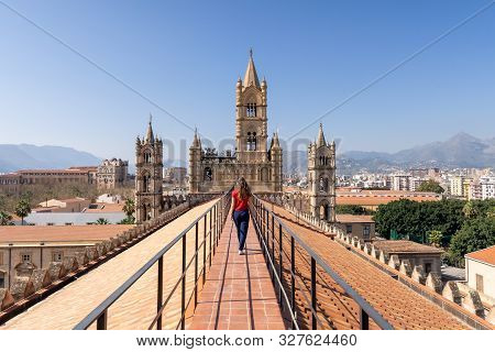 Woman Tourist Visitor Walking On The Rooftop Catwalk Of The Palermo Cathedral Or Cattedrale Di Paler