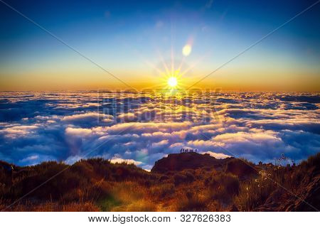 Nature Background With Sunrise Over Clouds. It Is On The Top Of Pico Do Arieiro Mountain, Madeira Is