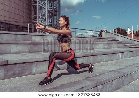 Girl Athlete In Summer In City Does Stretching And Gymnastics. Workout Before Morning Jogging, Fitne