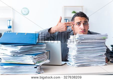 Businessman with heavy paperwork workload poster