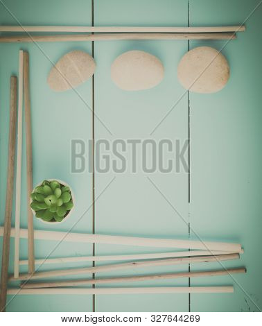 Stones And Plant On The Wooden Background