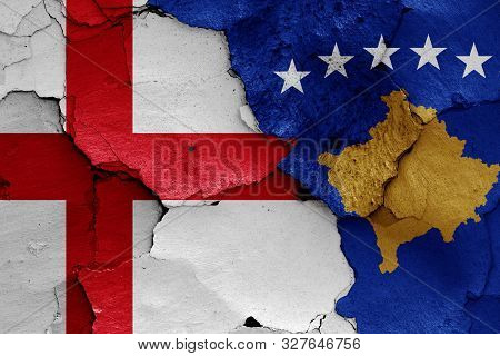 flags of England and Kosovo painted on cracked wall poster