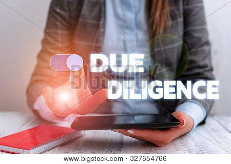 Conceptual hand writing showing Due Diligence. Business photo showcasing Comprehensive Appraisal Voluntary Investigation Audit Business concept with communication mobile phone. poster