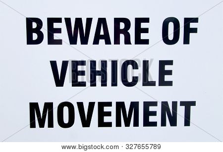 Beware Of Vehicle Movement Sig Outside A House In A Street.