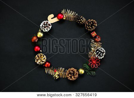Chirstmas Wreath Decoration. Flat Lay, Top View. Black Background. Copy Space.