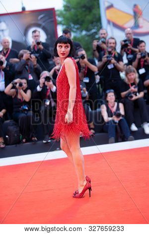 """Alice Pagani walks the red carpet ahead of the """"Joker"""" screening during the 76th Venice Film Festival at Sala Grande on August 31, 2019 in Venice, Italy."""