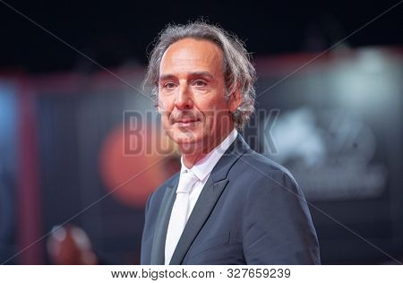 Alexandre Desplat attends the Jaeger Lecoultre Glory To The Filmmaker Award 2019 Red Carpet during the 76th Venice Film Festival at Sala Grande on August 31, 2019 in Venice, Italy.