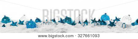 Christmas border with blue ornaments on snow isolated on white background
