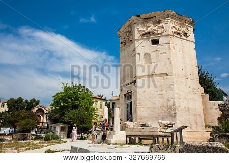 Athens, Greece - April, 2018: Tourists Visiting The Tower Of The Winds Or The Horologion Of Andronik