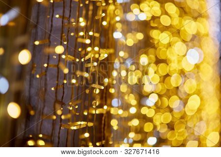 Festive background with LED lights garland. Christmas and New Year background. Blurred bokeh from the lights of a garland.
