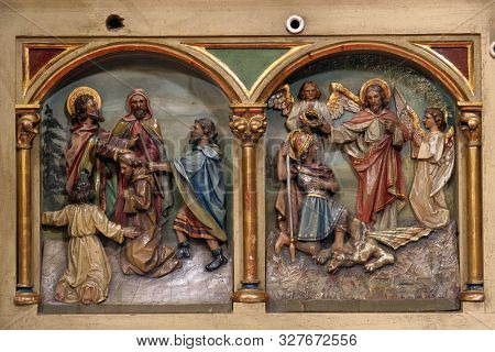 IVANIC GRAD, CROATIA - SEPTEMBER 25, 2011: Saints Cyril and Methodius and Saint George, main altar of the Visitation of Mary in the church of the Saint Peter in Ivanic Grad, Croatia
