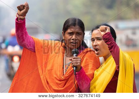 BHUBANESWAR, INDIA, JANUARY 11, 2019 : Two demonstration leaders are talking in microphone to fight against their retirement income lowering
