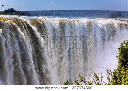 Victoria National Park, the Zambezi River. Journey after the wet season. Grand and deep Victoria Falls after the rainy season. Concept of extreme and photo tourism