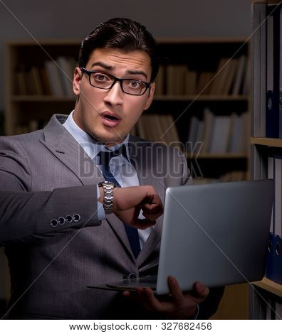 Businessman working late hours in the office