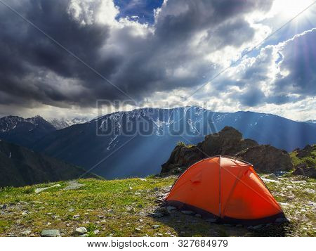 Camping Tent In The Mountains On A Cloudy Day.