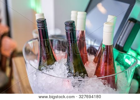 Rose Flowers Ice Cooled Sparkling Wine And Champagne Bottle In Bucket On A Party Unlabeled Textspace