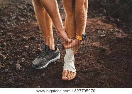 Male Runner Holding Injured Leg Close-up And Suffering With Pain. Leg Injury. Sprain Ligament Or Ten