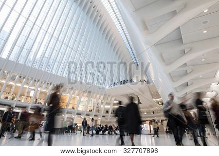 NEW YORK, NEW YORK-OCTOBER 12, 2019: Commuters move through the Oculus Hub in downtown New York City in this long exposure.