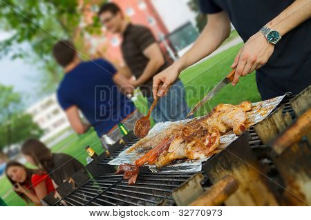 Chicken quarters and sausages on the grill. poster