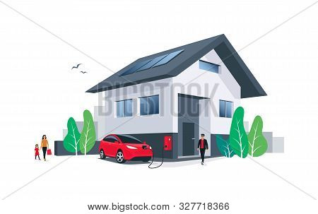 Red Electric Car Parking Charging At Home Wall Box Charger Station On House With A Man. Renewable En