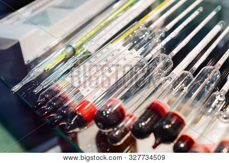 Glass Thermometers And Density Meters. Instruments For Measuring Temperature And Fluid Density. Rese