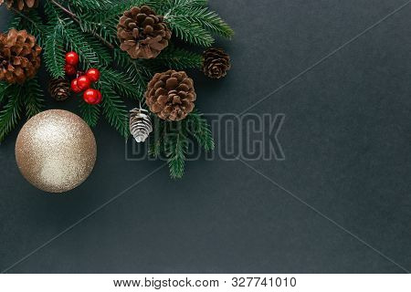 Black Granite With Christmas Decor Pine Leaf, Pine Cones, Holly Balls And Luxury Glitter Golden Ball