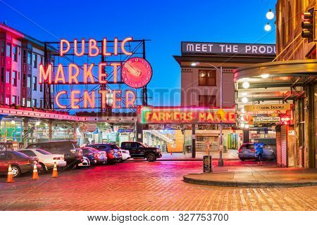 SEATTLE; WASHINGTON - July 2; 2018: Pike Place Market at night. The popular tourist destination opened in 1907 and is one of the oldest continuously operated public markets in the United states.