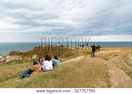 Etretat, Seine-maritime / France - 14 August 2019:  Tourists Enjoy Hiking And Picknicking On The Nor