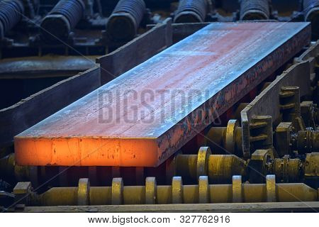 Hot Steel Plate On Conveyor Inside Of Steel Plant