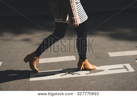 Woman Legs Walk On Street. Woman Legs Walk On Street In Brown Shoes. Woman Legs Side View. Close Up