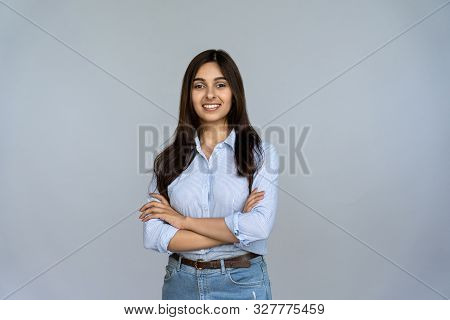 Smiling Indian Young Woman Sales Professional Arms Crossed Looking At Camera Isolated On Grey Blank