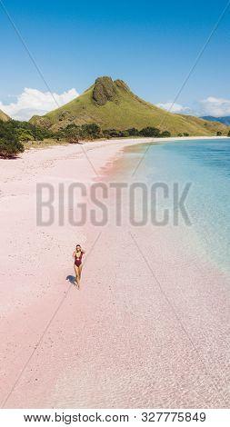 Woman Walking And Enjoying Empty Paradise Tropical Beach. 16:9 For Phone Screen Saver Wallpaper. Aer