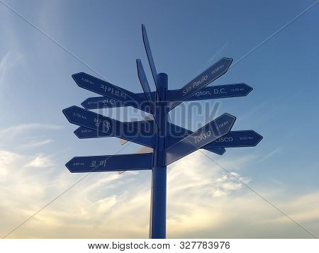 Sign Of Direction To Destination Cities Across The World With Distance Information. Taken In Seoul,