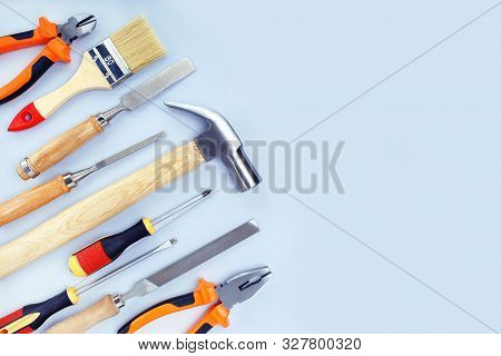 Different Construction Tools For Home Renovation On Grey Background With Copy Space. Maintenance And